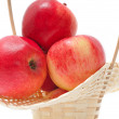 Red apples in basket — Stock Photo