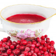 Cranberries and sauce — Stock Photo