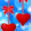 Two read hearts hanging — Stock Photo