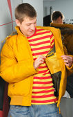 Boy in jacket stay in fitting-room — Стоковое фото
