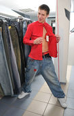 Adult boy in shop — Stock Photo