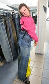 Boy doing choice in shop — Stock Photo