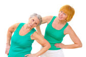Two smiling women doing gymnastics — Stockfoto