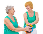 Daughter and mother doing gymnastics with ball — Stock Photo