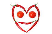 Face from paprica and tomatos — Stock fotografie