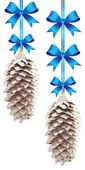 Pine cones with blue bows — Stock Photo