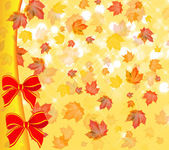 Maple fall leafs and two red bows — Stock Photo