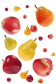 Flying red apples and colorful pears — Stock Photo