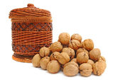 Heap of nuts and basket — Stock Photo