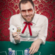 Man Playing Blackjack Holds Up Winning Hand — Stock Photo