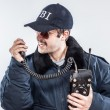 Angry FBI agent in situaiton with blue jacket, retro radio, and cap — Stock Photo #10648586
