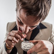 Royalty-Free Stock Photo: Young White Male Drug User Snorting Cocaine in Suit