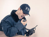Furious FBI man wearing blue jacket, sunglasses on vintage radio — Stock Photo
