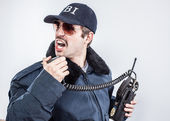 Action FBI agent wearing blue jacket, sunglasses with vintage mustache — Stock Photo