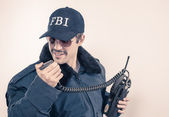 Investigative cocky FBI agent wearing blue jacket, sunglasses, and mustache — Stock Photo