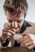 Vintage business man with gold watch snorting cocaine on table. — Stock Photo