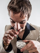 Gold watch vintage man snorting cocaine. — Stock Photo