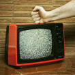 Fist smashing a TV — Stock Photo #8556904
