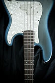Blue and ivory bass guitar — Stock Photo