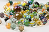 Wave of spilled colorful glass marbles — Stock Photo