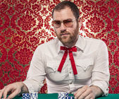 Confident Man Gambling Wearing Glasses, Texas Tie — Stock Photo