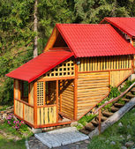 Building of the wooden house in wood — Photo