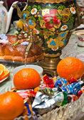 Russian samovar on a table with sweets — Stock Photo