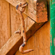 On wooden doors the old lock hook close-up — Stock Photo