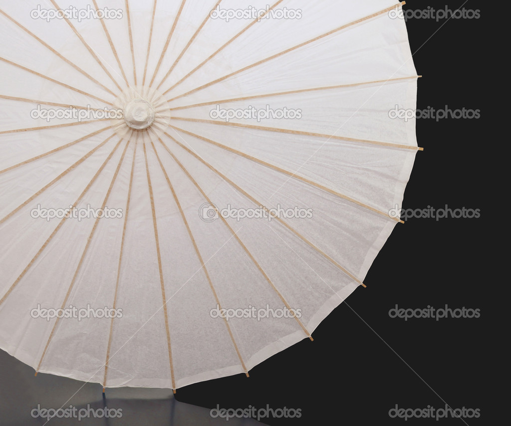 White paper umbrella with wood splines on black background — Stock Photo #10123989