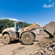 Bulldozer at work shifts of cast iron — Stock Photo