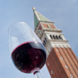 Glass of red wine with backdrop of piazzsmarco in Venice, — Photo #8692894