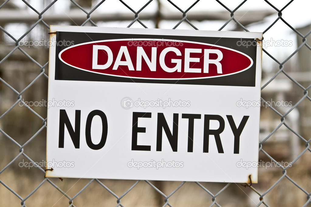 A sign attached to a chain-link fence that reads: DANGER NO ENTRY  Stock Photo #8792214