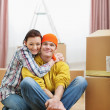 Portrait of moving young couple among boxes — Stock Photo #10552615