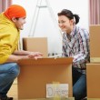 Moving young couple searching something in box — Stock Photo