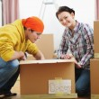 Young couple unpacking in new house — Stock Photo #10552626