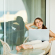 Happy woman enjoying free time with laptop on terrace — Stock Photo