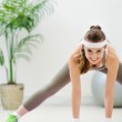 Happy fitness woman doing stretching exercises — Stock Photo #10553503