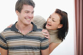 Portrait of smiling young couple having fun — Stock Photo