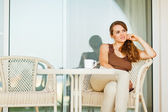 Thoughtful woman sitting on terrace — Stock Photo