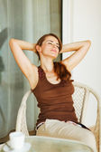 Young woman relaxing on terrace — Stock Photo