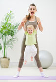 Mother and baby making gymnastics — Stock Photo