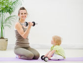 Mother and baby spending time doing fitness — Stock Photo