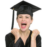 Portrait of excited graduation student woman isolated — Stock Photo