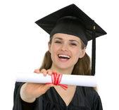 Happy graduation student woman showing diploma — Stock Photo