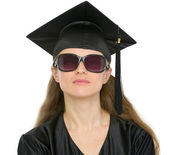 Portrait of cool graduation student in sunglasses — Stock Photo