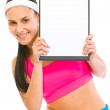 Smiling fit girl looking from blank clipboard — Stock Photo