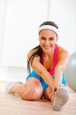 Smiling fitness woman making gymnastics exercise — Stock Photo