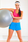 Smiling healthy girl holding fitness ball — Stock Photo