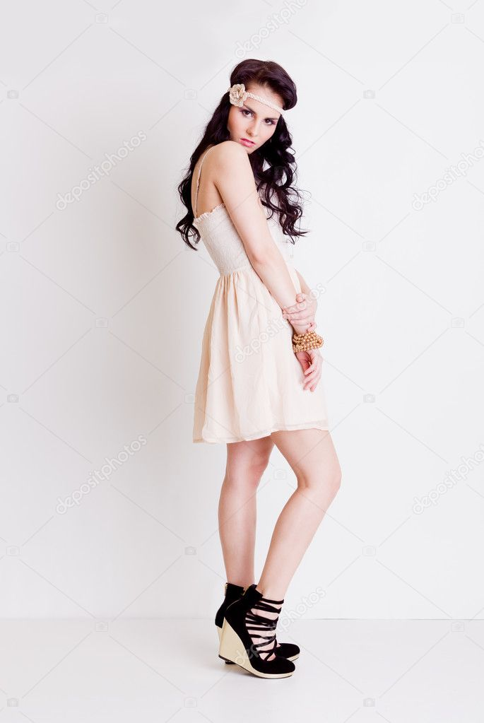 Full length Vogue style young girl posing in studio  Stock Photo #8569551