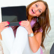 Cheerful lovely woman looking from laptop - Stockfoto